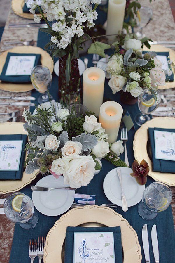 Photographer: Brandon Kidd Photography; Elegant blue wedding reception centerpiece idea