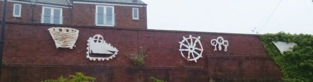 Sculptures on wall in carpark in South Shields, representing the area.