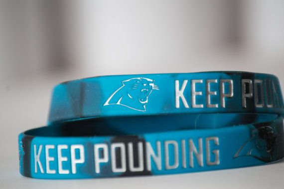 Carolina Panthers KEEP POUNDING silicone bracelet. Bracelet is approximately 8 inches in circumference and 1/2 inch wide. Each order receives 1