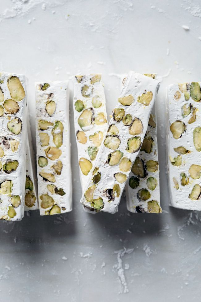 Nougat (Cubbaita, Gaz, Jabane, Mandorlato, Qubbajd, Torrone, Turron): Global sweet made with sugar or honey and egg whites with nuts or dried fruit.