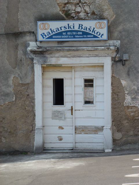 Bakarski baškot (bakery) - Bakar Town, Croatia.  Baškot is twice baked round bread bun that brought the fishermen of Chioggia. Because its the dryness could last more than six months and was very convenient for food on long voyages and wore instead of bread on long fishing trips, traditionally dipped in red wine, tea or latte. Today baškot one of the symbols and souvenirs Town of Bakar.
