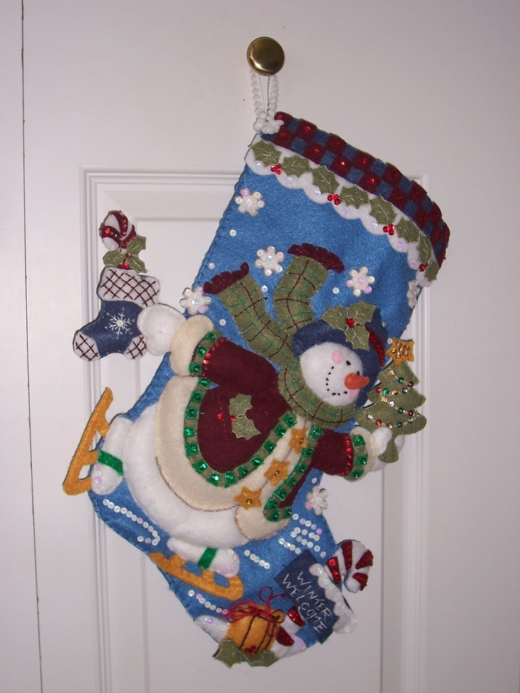3-D stockings.. made out of felt and sequins, beads..