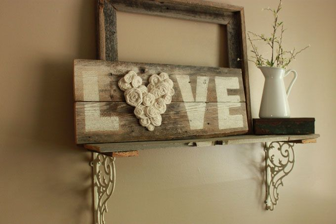 Fence wood *LOVE* sign Materials used: reclaimed fence wood, annie sloan chalk paint in old white, cream muslin and hot glue for rosettes