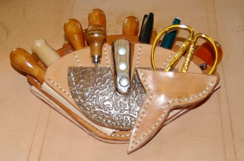Leather working tools        Google Image Result for http://toolmakingart.com/images/leather/Tool%2520Pouch/Tool%2520Holster%2520Front.jpg