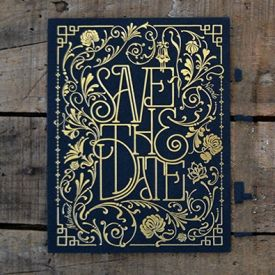 Art Deco themed save the date postcard. Letter pressed on black paper with gold foil.