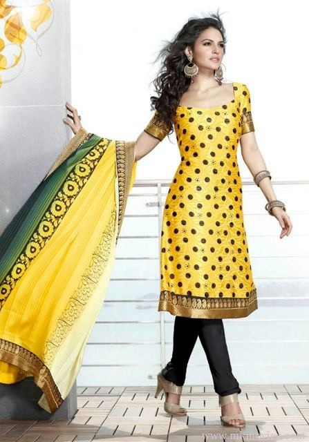 Extravagant-Eid-Salwar-Kameez-For-Pakistani-Girls-2012  i dont really like polka dots.. guess its an annoyance to my eyes... but this is cute.. and the dupatta ( the BIG long beautiful peice of cloth shes holding) that kinda hides the dots a little.. kinda cute