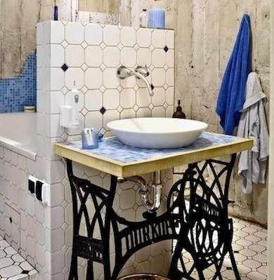 Old sewing table repurposed as DIY sink vanity