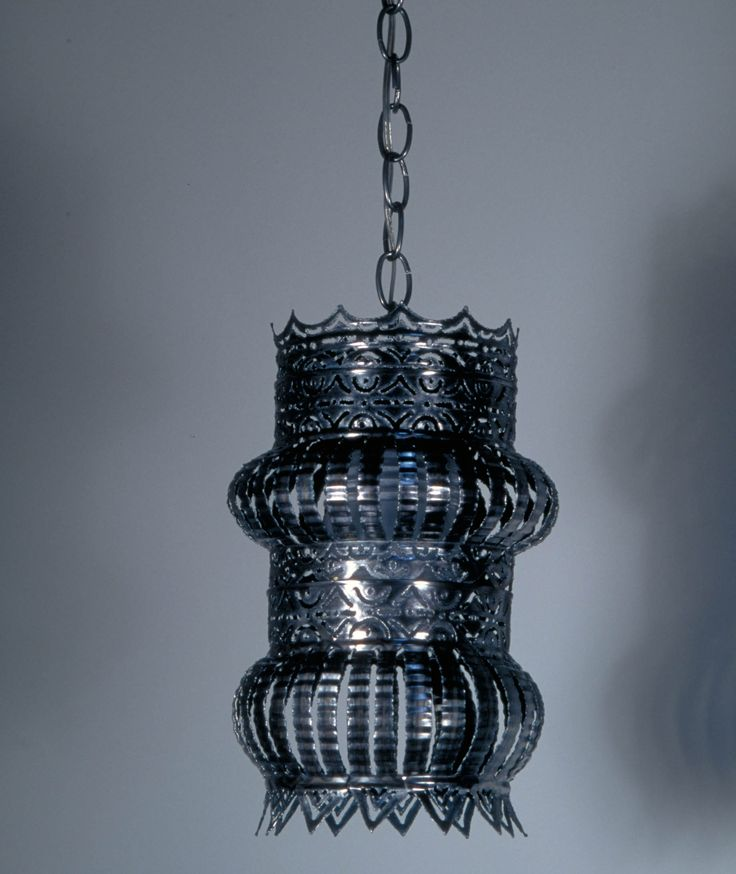 This is actually two coffee cans can you believe it... get me one, its beautiful and its found at http://www.fireflylighting.com/product-Recycled_Pendant_Light_-107.php