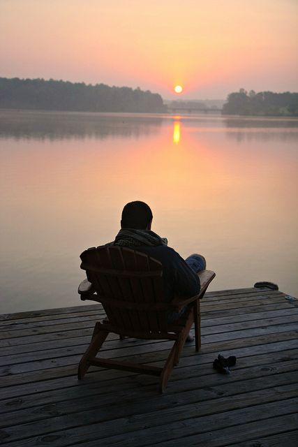 How wonderful to sit alone taking in the beauty of a sunset over the still water.