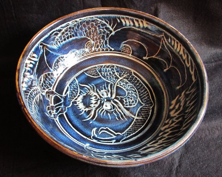 Very large Jabberwocky bowl, the jabberwock attempting to escape from the interior. Sgraffitto jun glaze.