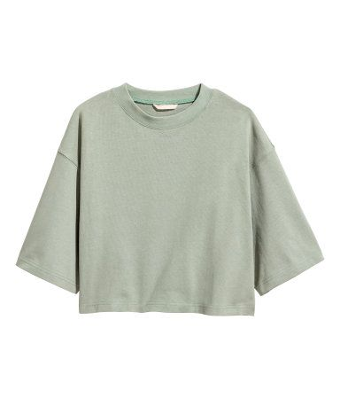 Light khaki green. Short, wide-cut sweatshirt with dropped shoulders and short, wide sleeves.