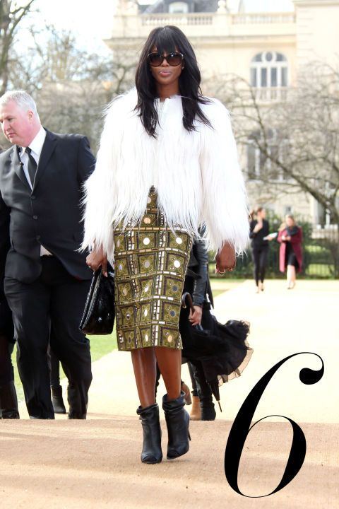 What: Burberry Where: Burberry Prorsum Fall 2015 Show Why: The supermodel commands attention in a luxe white fur jacket and embellished skirt.