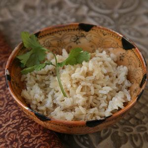 Coconut Brown Rice - just 3 main ingredients in this simple, alluring dish. Smashed ginger perfumes the coconut milk, which gives the brown jasmine rice a rich, velvety texture.