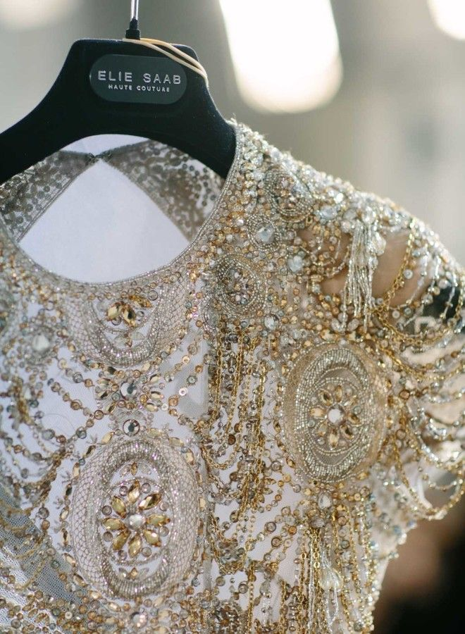Gold beaded Elie Saab wedding dress: http://www.stylemepretty.com/2017/01/29/elie-saab-haute-couture-ss17-paris-fashion-week/ Photography: Greg Finck - http://www.gregfinck.com/