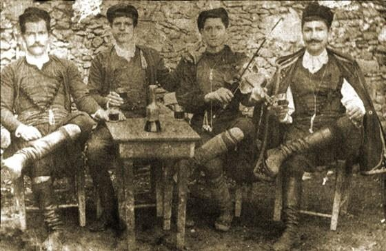 Cretans at a get-together with a fiddler, ealy 20th.