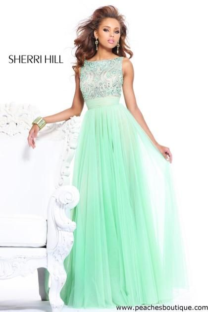 Sherri Hill mint green. I like things with sleeves or straps a lot, I'm starting to get tired of the same old strapless look.
