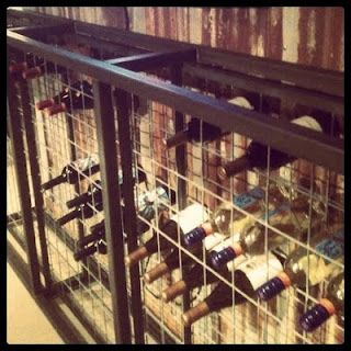 Wire fence wine rack at Frank in Nacodoches, TX