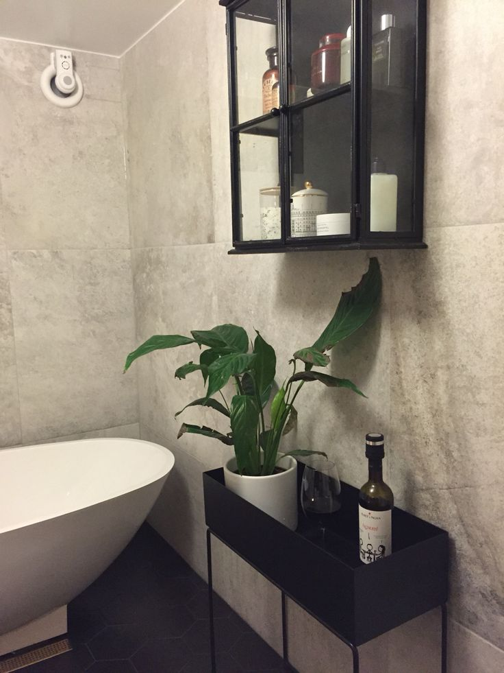 Our bathroom. Plant stand from ferm living and medicine cabinet from #vackrasaker