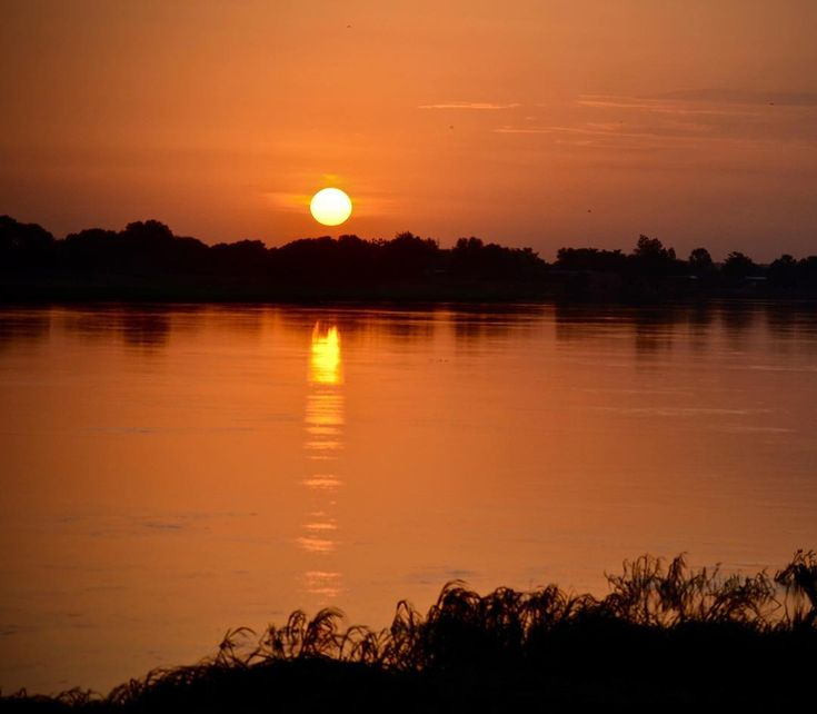 #tbt to one of Chris VanJohnson's trips to Chad. Flowing into Lake Chad the Chari River forms a large portion of the Chad-Cameroon border.  It's beautiful at sunset but is a major security concern as Chad resists Boko Haram incursions. #Chad #Cameroon #travel #nature #sunset #scenic #SoA #nonprofit #photography
