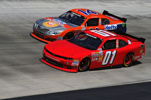 Landon Cassill, driver of the #01 teamjdmotorsports.com Chevrolet, races Eric McClure, driver of the #14 Hefty Ultimate / Renynolds Wrap Toyota, during the NASCAR Nationwide Series Drive To Stop Diabetes 300 at Bristol Motor Speedway on March 15, 2014 in Bristol, Tennessee.