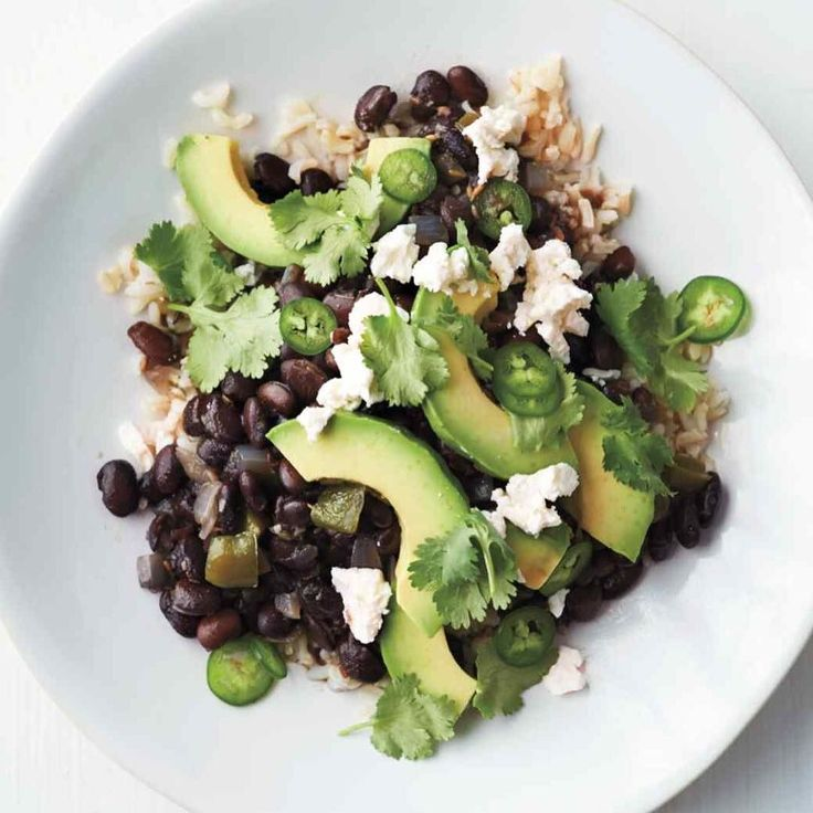 Old fashioned rice and beans never disappoints just add jalapeno avocado cilantro and @kitehillfoods vegan ricotta and you have a healthy complete meal.FYI I always buy sprouted rice and beans or I soak them before cooking to help with digestion.