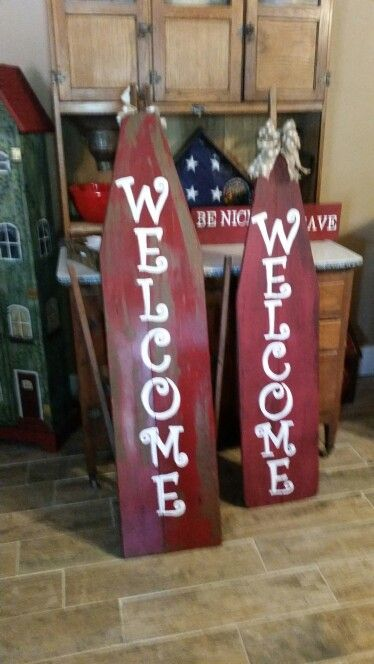 Welcome signs out of old wooden ironing boards! Fun way to say hello!