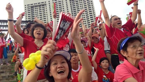 Singapore National Day Parade 2014: Spectators dressed in patriotic red and white. http://www.straitstimes.com/ndp2014 Photo: Neo Xiaobin/The Straits Times