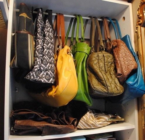 Purse storage using tension rod (add shower curtain hooks) hang in top of closet with all that wasted space.