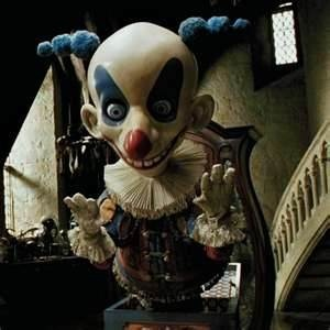 Harry Potter and the Prisoner of Azkaban -- directed by Alfonso Cuaron, it's my favorite and features an outstanding creepy clown
