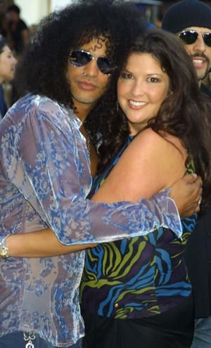 The iconic rock couple, Velvet Revolver and ex-Guns NRoses guitarist Slash with his wife, Perla Hudson, at a film premiere.