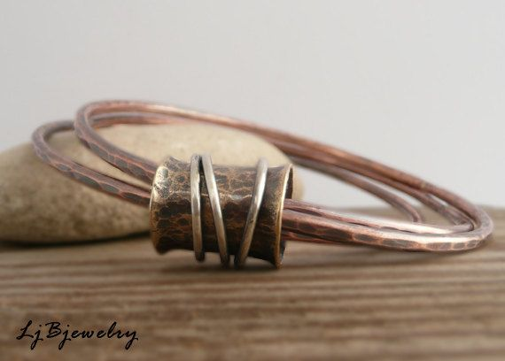 Triple Bangle with Spinner Ring, Copper, Red Brass, Sterling Silver, Earthy Organic Style. $51.00, via Etsy.