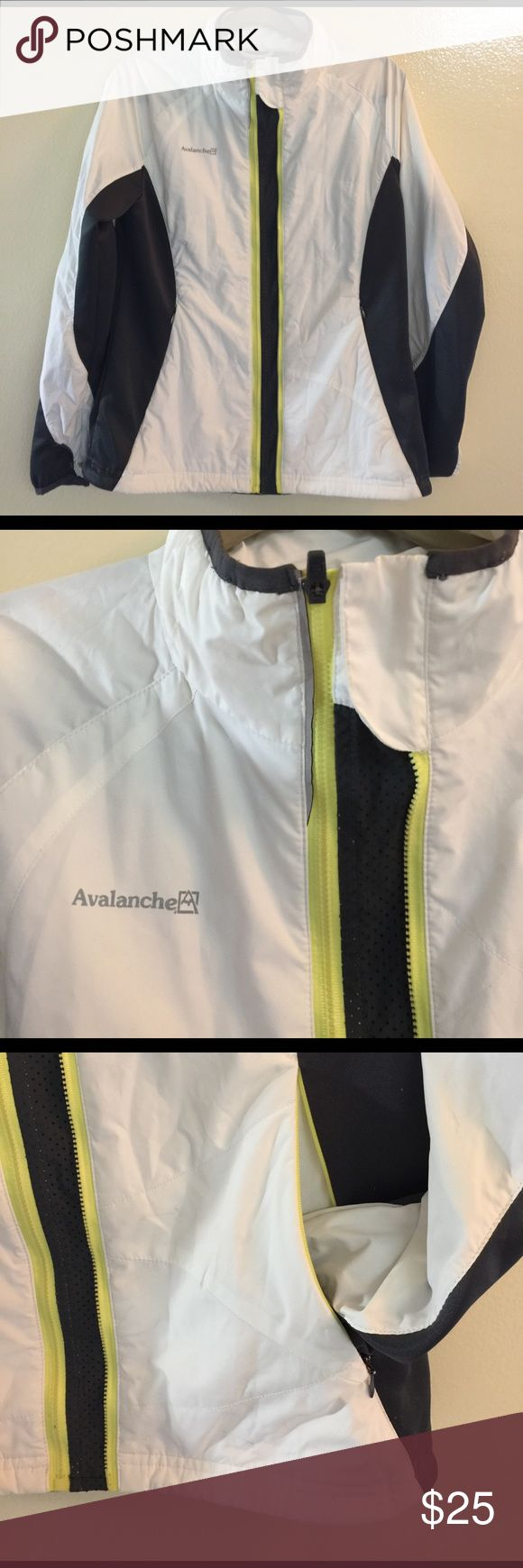 Avalanche Black /White Women's Running Jacket This is a gorgeous black and white jacket for the serious runner as it has a insulated running shell and thumb holes at bottom of sleeve. It is in great seldom used condition. It has yelled w trim on zipper and has a very classic look. You will love it! It is made of Polyester and Spandex. Avalanche Jackets & Coats Utility Jackets