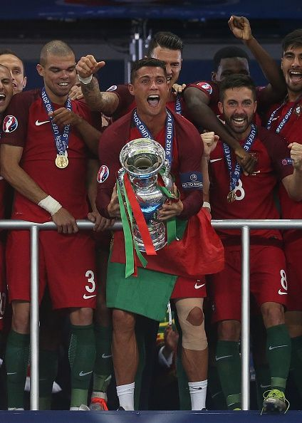 #EURO2016 Cristiano Ronaldo of Portugal lifts the trophy following the UEFA Euro 2016 Final match between Portugal and France at Stade de France on July 10...