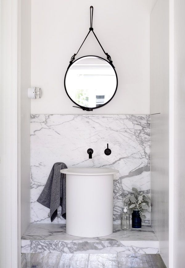 Light grey marble and black strap mirror.