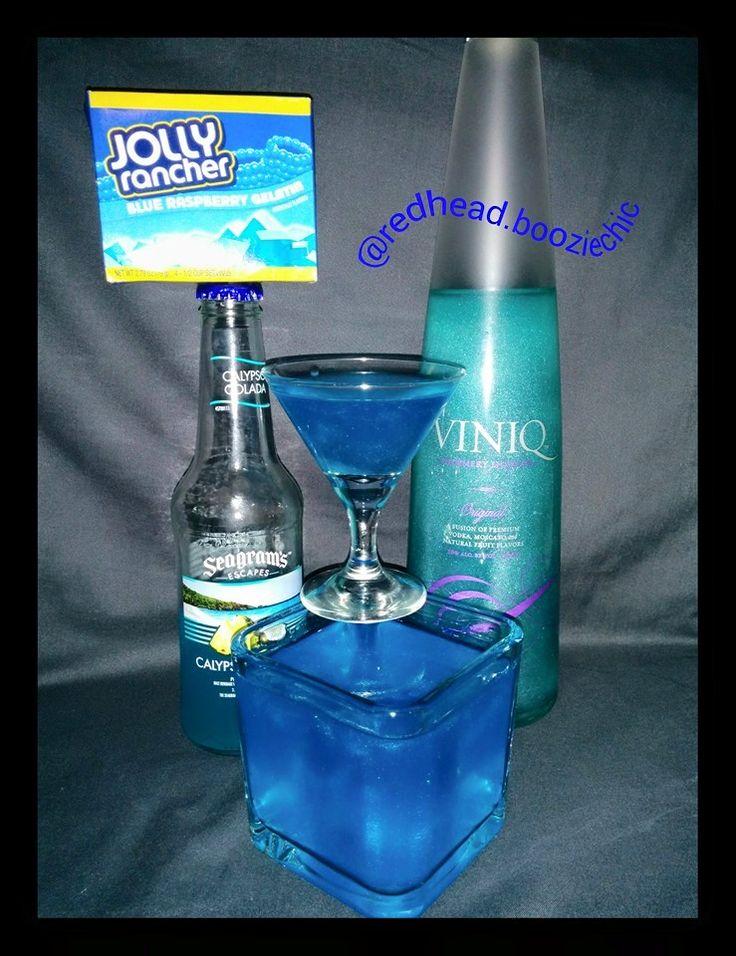 Viniq Blue Raspberry Coconut Jello Shot 1 box raspberry jello 1 cup Seagram's Calypso Colada Wine Cooler 1/2 cup water  1/2 cup Teal Viniq