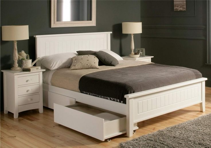 White Painted Wooden Bed Frames With Shelves With Queen Size Mattress Connected Grey Painted Wall And Table Lamp Also Grey Carpet And Wooden Floor With Underneath Bed Storage  Plus Bed Storage Base