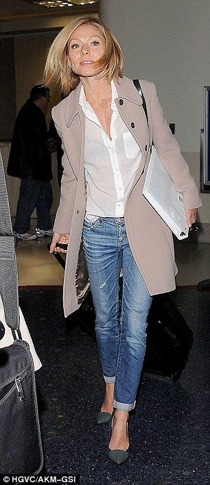 What a stunner! The All My Children actress breezed by photographers with her rolling suit case #denim #jeans