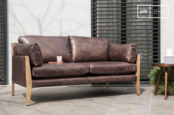Un sofá vintage con el estilo de los muebles nórdicos de los 60 pero con el confort de los muebles modernos.