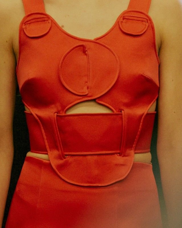 Slits and tab construction backstage at Christopher Kane AW15 LFW. See more here: http://www.dazeddigital.com/fashion/article/23778/1/christopher-kane-aw15