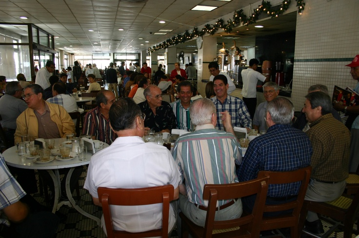 patrons at Cafe de la Parroquia  100+ years Coffee shop and restaurant, obligated visit during your stay the the city  of Veracruz, Mexico