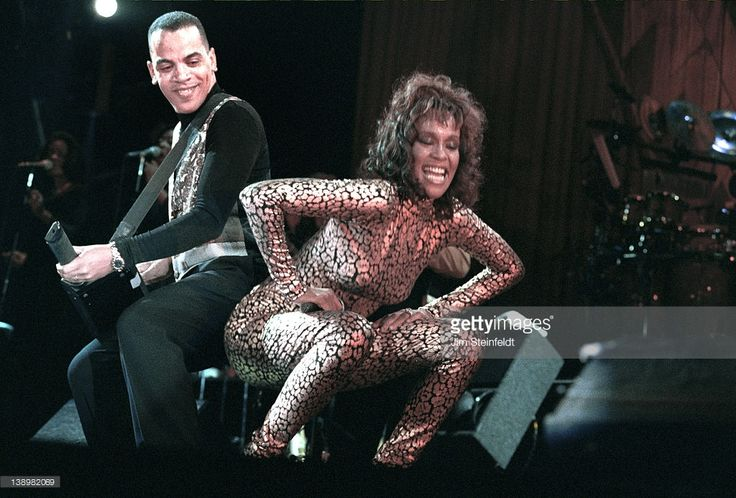 Whitney Houston and band leader Rickey Minor perform at the Target Center in Minneapolis, Minnesota in 1994.