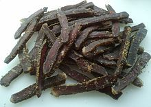 Biltong is a variety of cured meat that was originated in South Africa. Various types of meat are used to produce it, ranging from beef and game meats to fillets of ostrich from commercial farms. It is typically made from raw fillets of meat cut into strips following the grain of the muscle, or flat pieces sliced across the grain.
