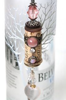What a neat idea...decorate wine corks and hang on wine bottle. Could also be used as an ornament.