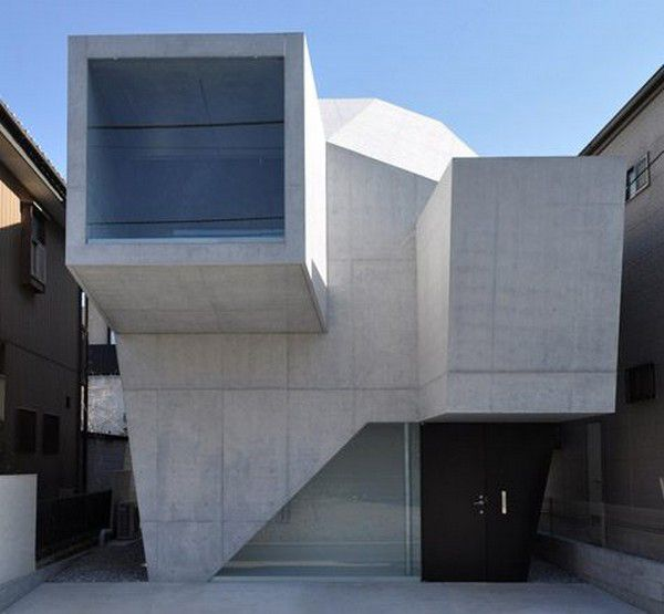 This modern shape architecture certainly creates a striking silhouette on this residential avenue in Abiko, Japan. Japanese architecture firm Shigeru Fuse Architects created a design that, as requested by its owners, would resemble a gallery space. The result is an open concept house design with exposed concrete walls that give the house a modern industrial edge.  Shigeru Fuse Architects photo credit: H. Ueda