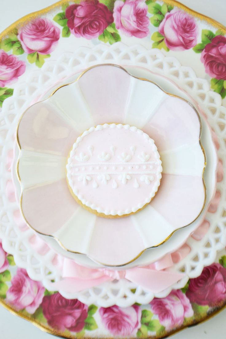 Pretty pink cookies for a shower by Bake Sale Toronto. China from Vintage Dish Rental.
