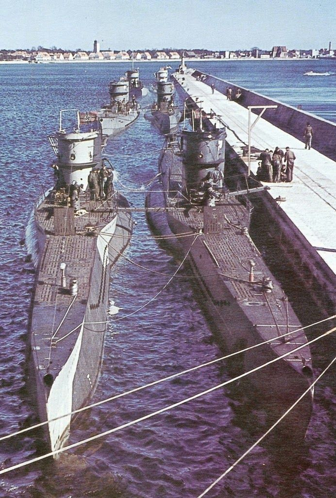 Rare colour photograph of U- Boats Type VIIs in harbour.