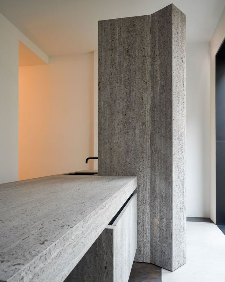 Kitchen by Glenn Sestig and Obumex in Iranian titanium travertine