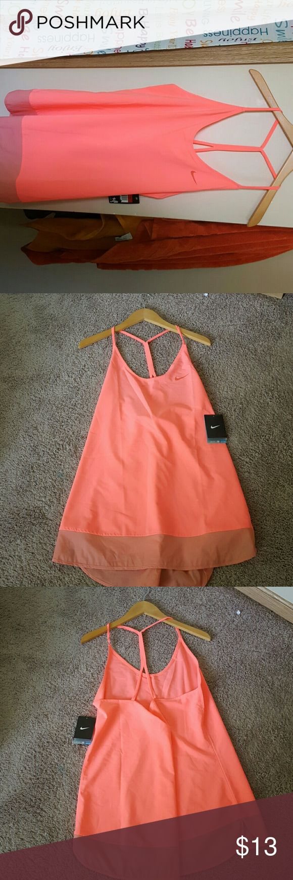 Dri-Fit Nike Tank Top This neon pink Nike Tank top is perfect to wear when playing sports, running, or even jogging. Nike Tops Tank Tops