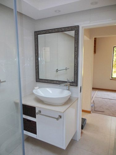 Completely new bathroom. New floor & wall tiles, cupboards, cupboard top, electrics, fittings, plumbing, cornices, painted ceiling & bulkhead.