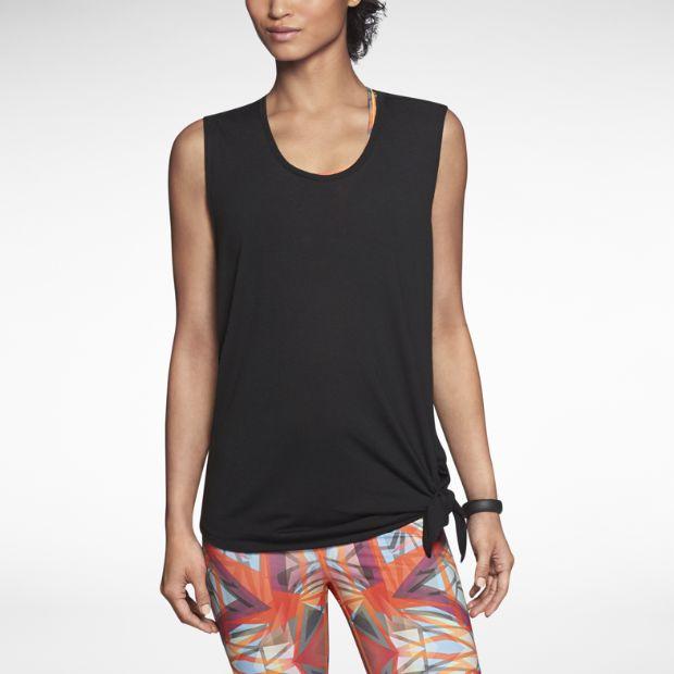 Black Nike Dri-FIT top, features an asymmetrical hem. You can tie it up or wear it long.